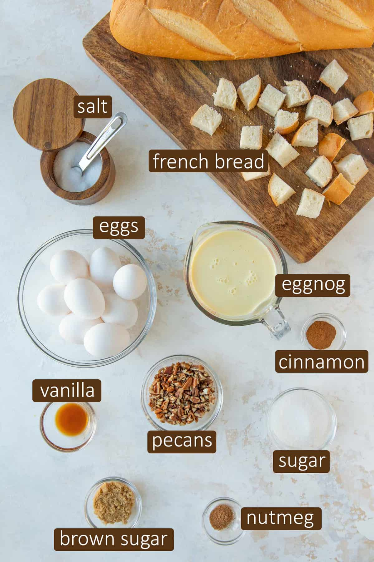 Overhead view of ingredients for overnight eggnog French toast casserole.