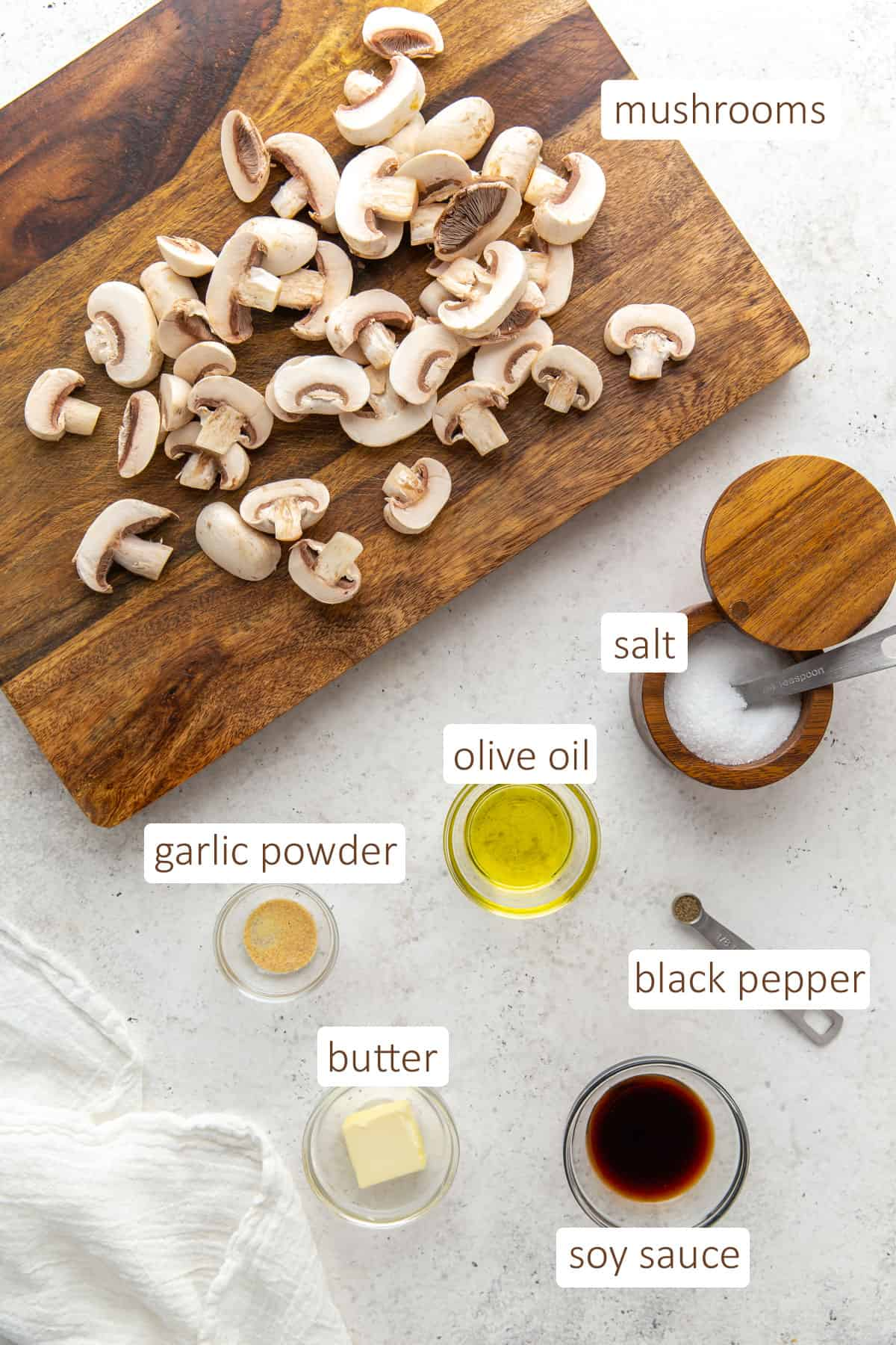 Overhead view of ingredients needed to prepare sauteed mushrooms.