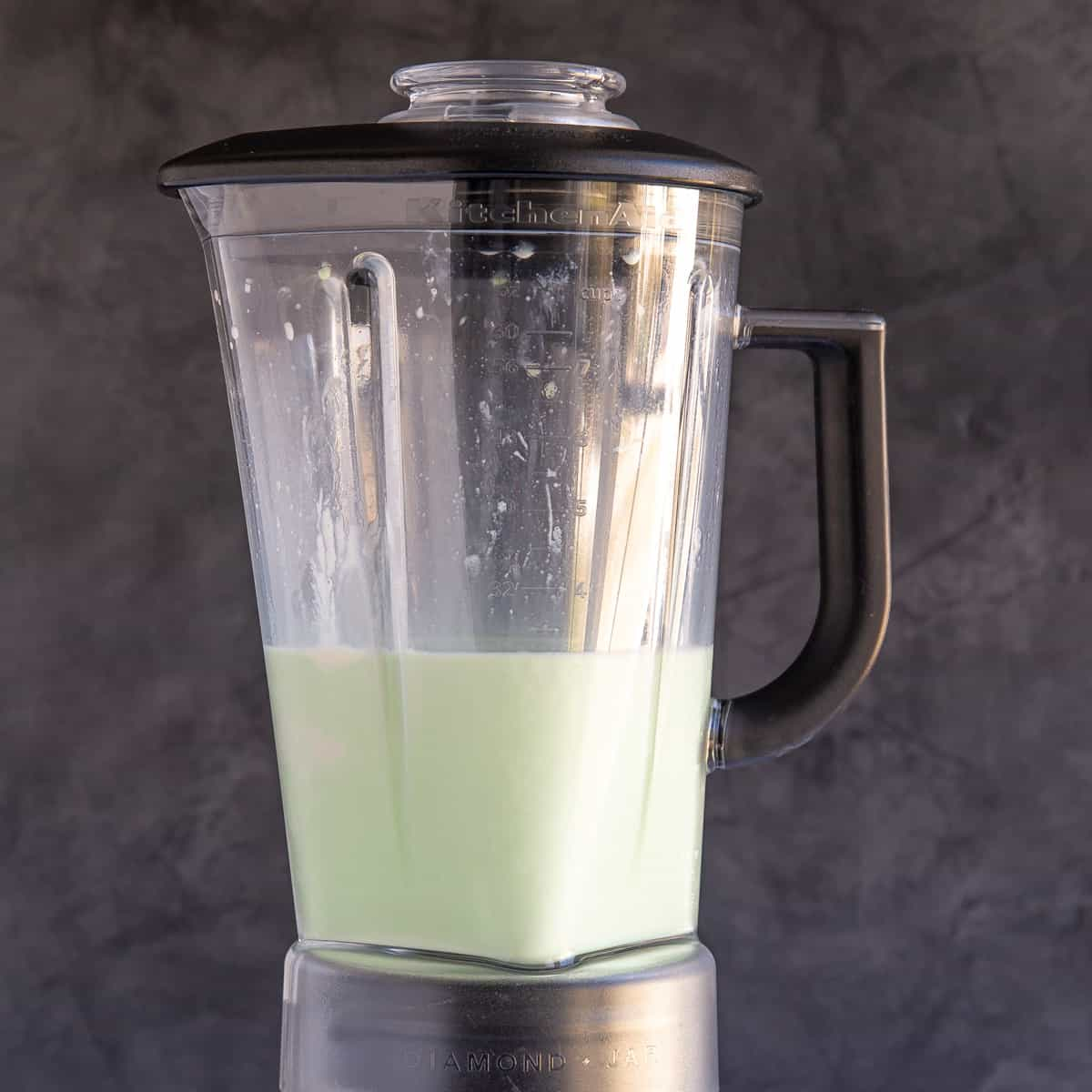 Front view of boozy shamrock shake in a blender pitcher.