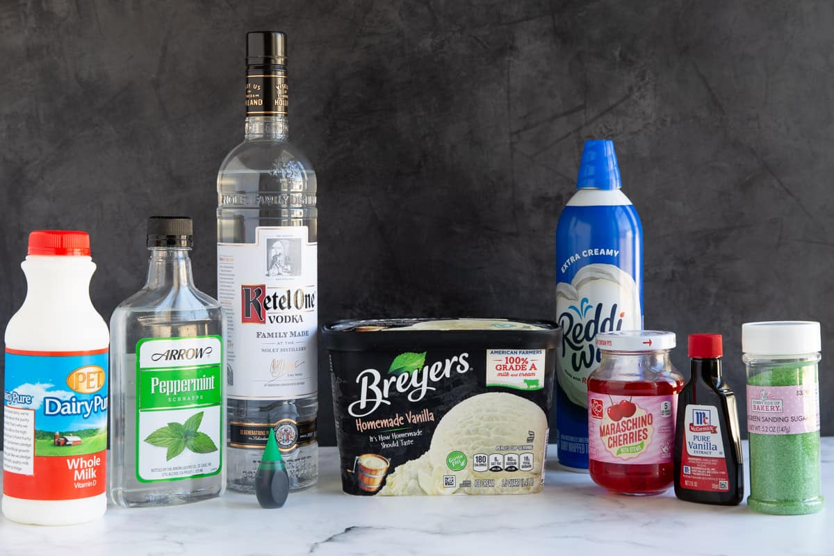 Front view of ingredients for boozy shamrock shakes.