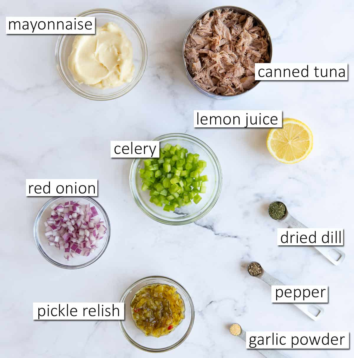 Overhead view of ingredients needed to make tuna salad.