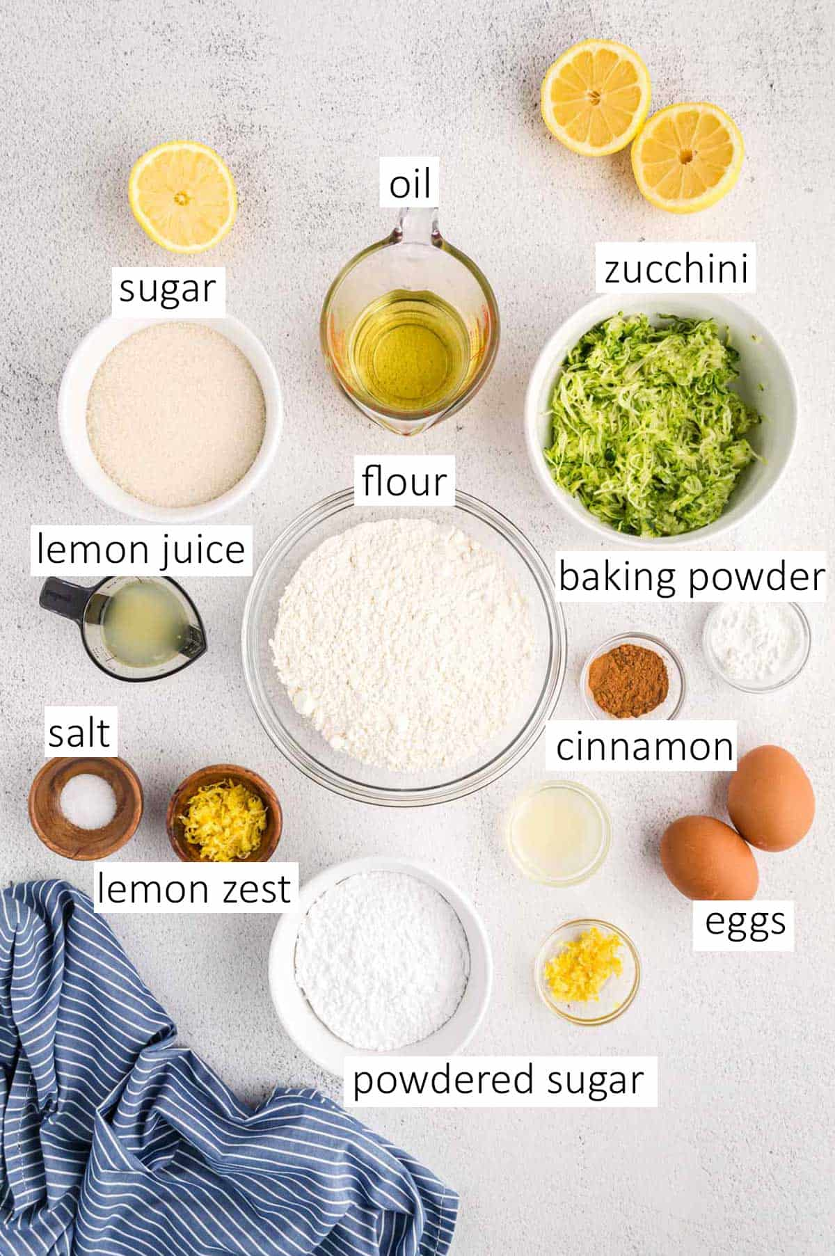 Overhead view of ingredients needed for lemon zucchini loaf bread.