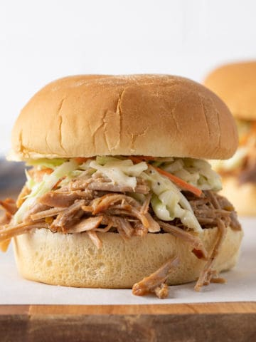 Front closeup view of a pulled pork sandwich.