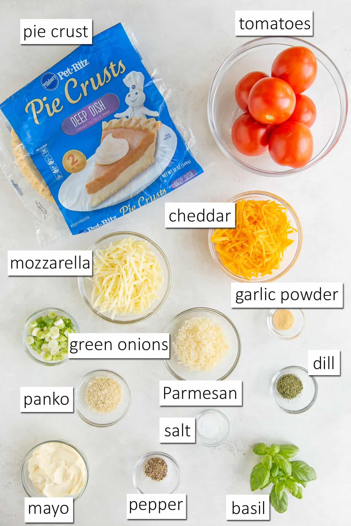 Overhead view of ingredients needed to make southern tomato pie.