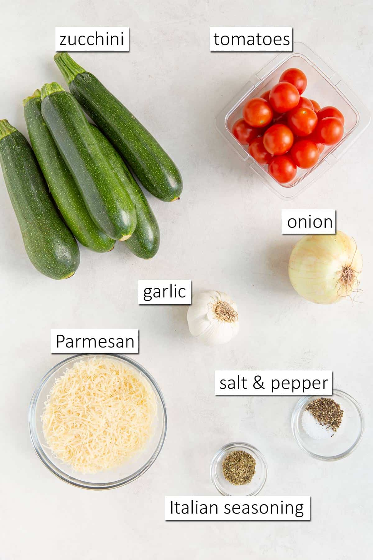 Overhead view of ingredients needed for zucchini tomato bake.