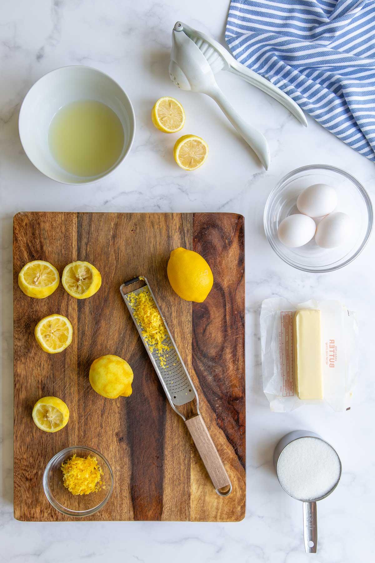 Overhead view of ingredients needed to make microwave lemon curd.
