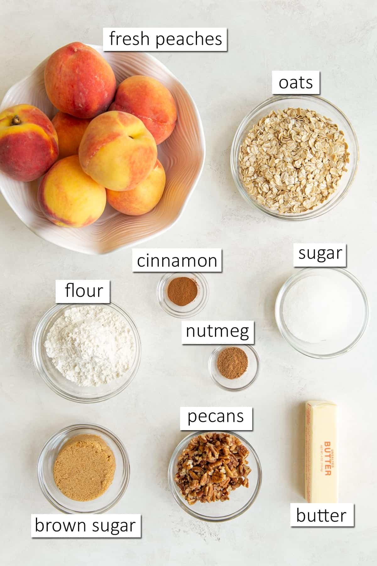 Overhead view of ingredients for making fresh peach crisp.