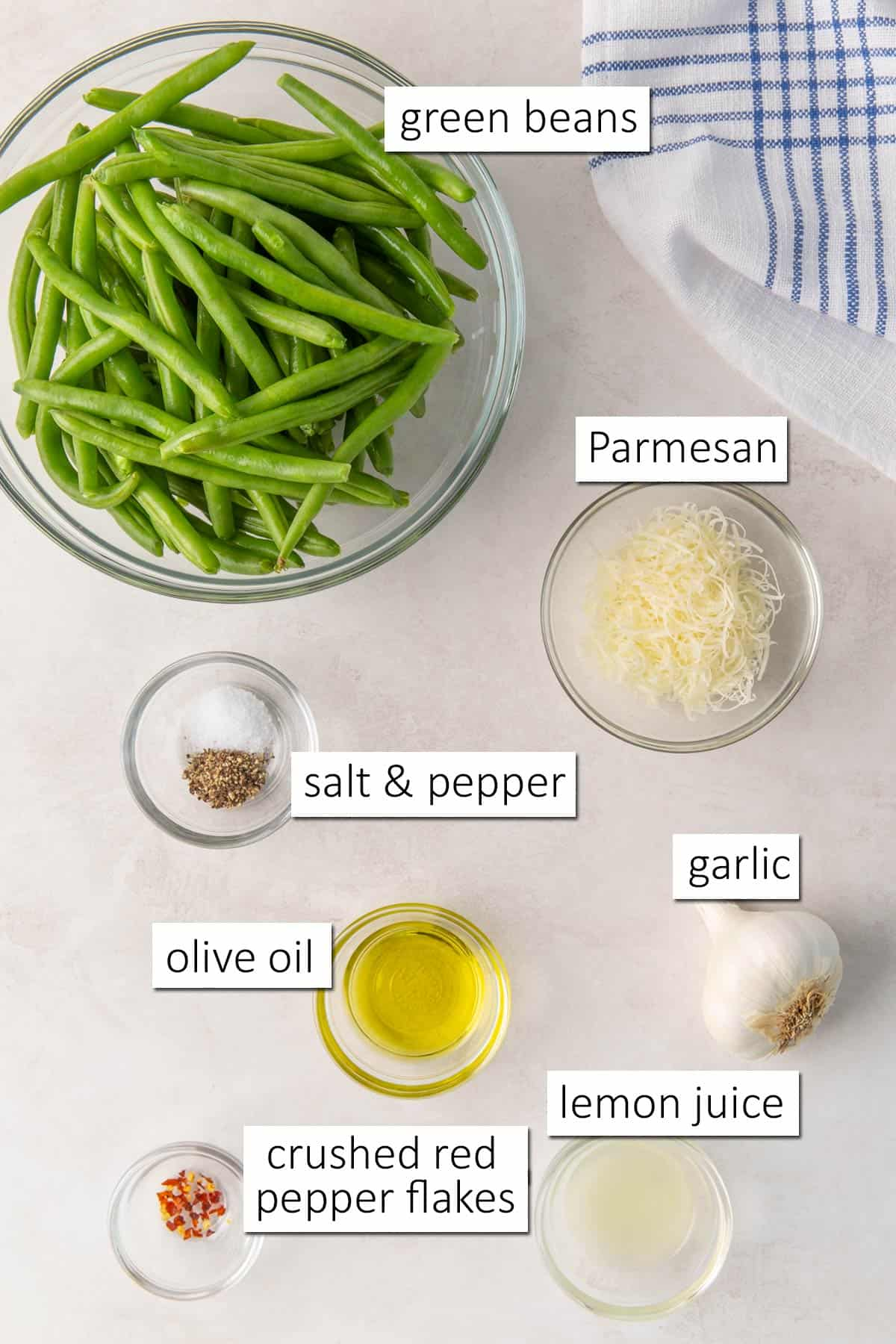 Overhead view of ingredients for sautéed green beans with garlic and Parmesan.