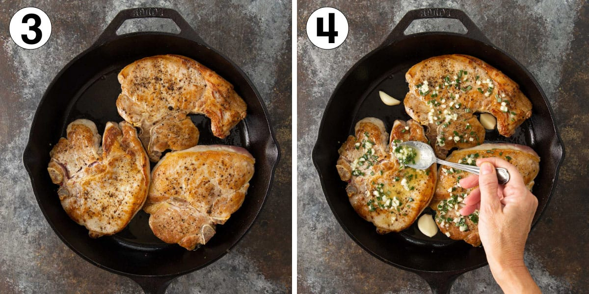 Seared pork chops in a skillet being coated with a butter, rosemary and garlic mixture.